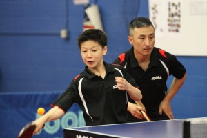 Nick Tio and June Lim in doubles action