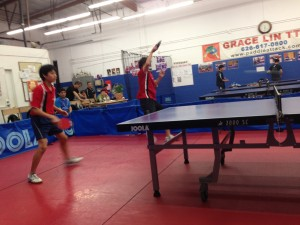 Newman Cheng and Ethan Chua in doubles action