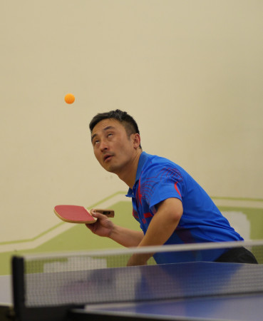 June Lim keeps his eyes on the ball when serving