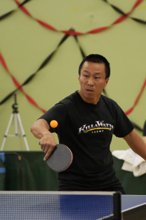 Tom Nguyen sets up to flip a backhand winner