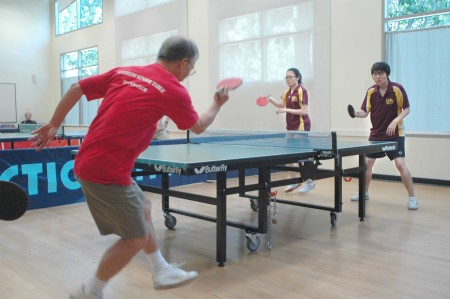 Doubles, Left to right Golden Ninja Fred Liao with back to camera in the foreground, against Gloria Deng and Franz Zhao