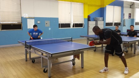 Simon serves to Alex at the start of the game in a very close match. The difference in total points scored was only 5.