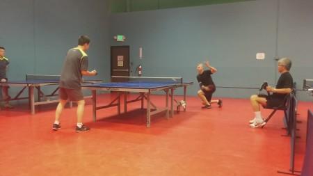 Roger Gorani vs Xiaodong Liu, Tom Liu keeping score, and Perry Chang umpiring